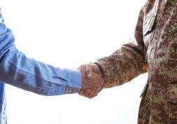 veteran shaking mans hand senior care franchise opportunity